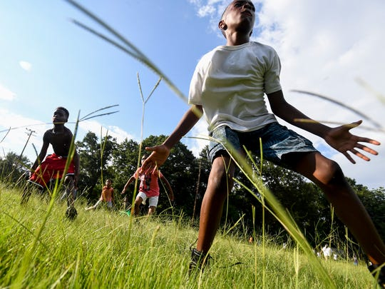 Football practice is held in Diffley Park across the street from the West End Boys and Girls Club on Crenshaw Street in Montgomery, Ala, on Monday July 9, 2018.