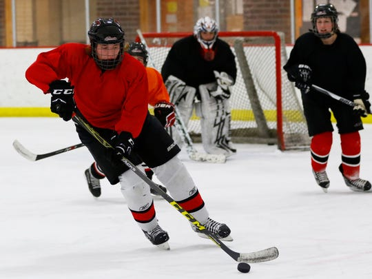 The Red Panthers girls hockey team works on drills during Thursday practice at Marshfield Youth Ice and Recreation Center in Marshfield.