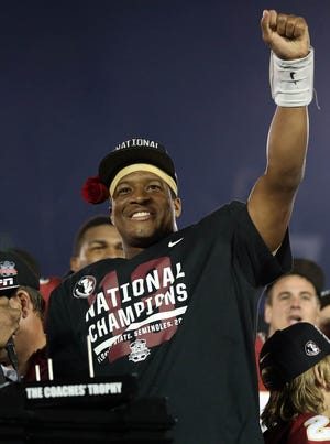 Florida State Seminoles quarterback Jameis Winston celebrates after defeating the Auburn Tigers 34-31 in the 2014 BCS National Championship game at the Rose Bowl.