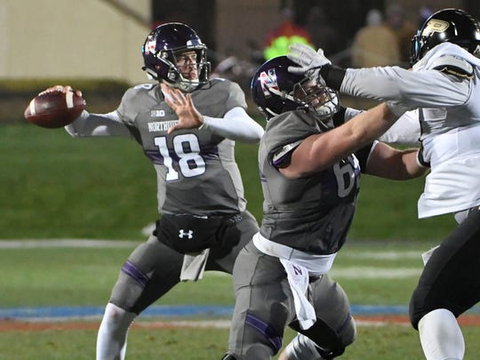 Northwestern Wildcats quarterback Clayton Thorson (18) passes the ball against the Purdue Boilermakers.