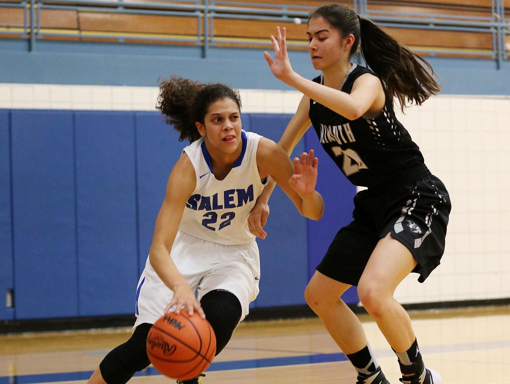 Salem sophomore Lasha Petree (No. 22) tries to dribble around Plymouth senior Bailey Brown (No. 20) during Tuesday's opener.