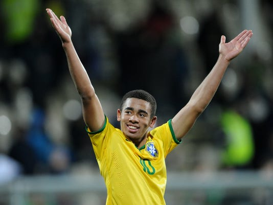 FILE - In this June 17, 2015 file photo, Brazil's Gabriel Jesus celebrates following a U20 soccer World Cup semifinal game against Senegal in Christchurch, New Zealand. Brazil football fans are more excited with their young Olympic team than with the squad playing now at Copa America Centenario in the United States. The main reason is 19-year-old Jesus, a striker at Sao Paulo club Palmeiras, who may wind up being the star in the Olympics as Brazil shoots for its first soccer gold medal.(AP Photo/Ross Setford, File)