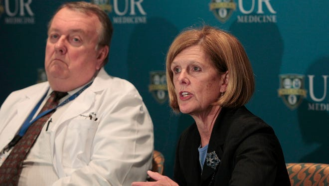 Kathleen Parrinello, RN, PhD, right, joined by Raymond Mayewski, MD, left, talks about the training of staff at Strong Hospital for treating possible Ebola cases in the eastern United States during a press conference at Strong Memorial Friday.