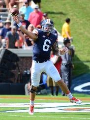 University of Virginia quarterback Kurt Benkert throws