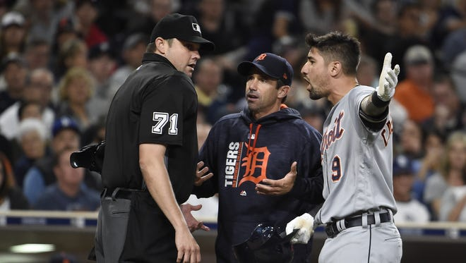 Tigers manager Brad Ausmus, center, and third baseman Nick Castellanos argue a call with umpire Jordan Baker during the fifth inning Saturday in San Diego.