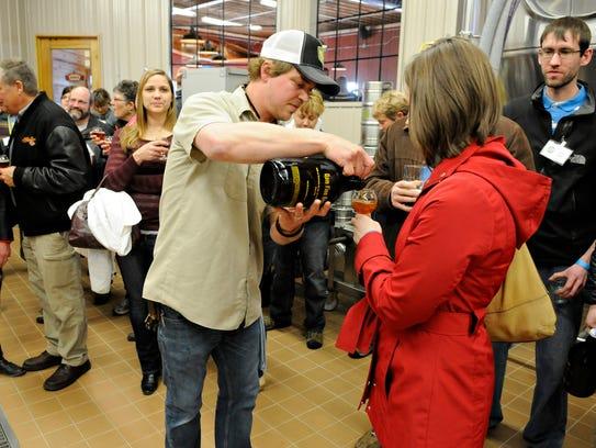 Beaver Island Brewing Co. co-owner Matt Studer pours