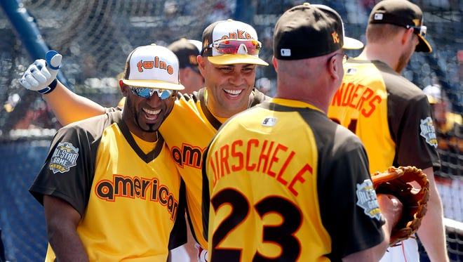 American League's Eduardo Nunez, of the Minnesota Twins, left, and Carlos Beltran, of the New York Yankees, laugh during batting practice prior to the MLB baseball All-Star Home Run Derby, Monday, July 11, 2016, in San Diego.