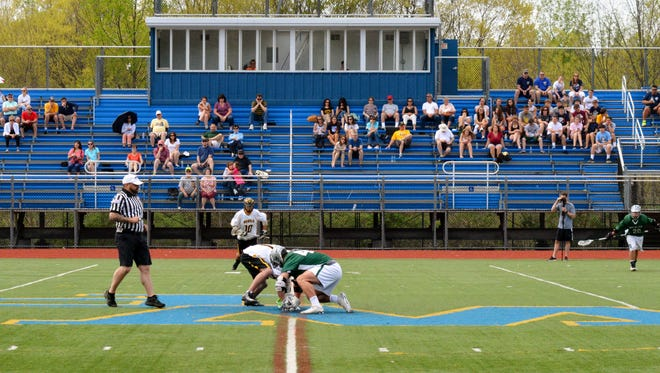 Fans watch Lakeland/Panas host Brewster in a boys lacrosse game on April 29, 2017.