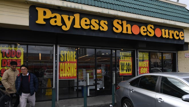 Customers leave a Payless Shoes store in Los Angeles, California on February 17, 2019 after the company announced it will close all 2,100 of its locations in the United States and Puerto Rico by May.