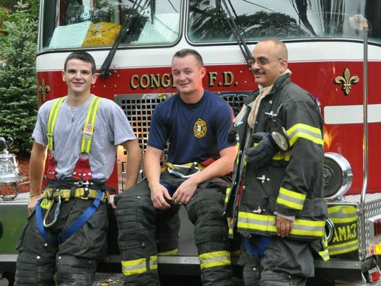 Gary Baisley (center) with the Congers Fire Department