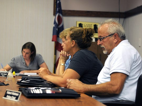 Members of Port Clinton's city council attend Thursday night's special meeting to adopt Ordinance 16-15, creating an issue on the ballot for the November election.
