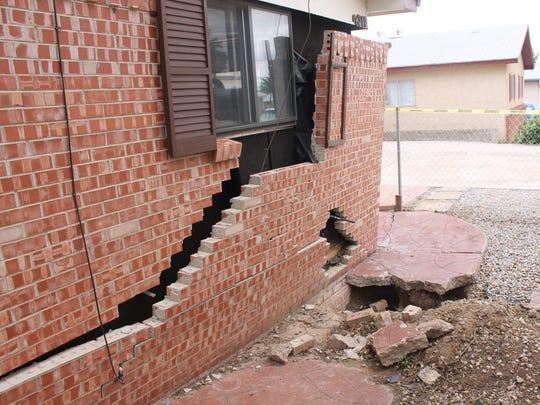 Due to water erosion on the northeast corner of this structure, the brick veneer has separated from the home.