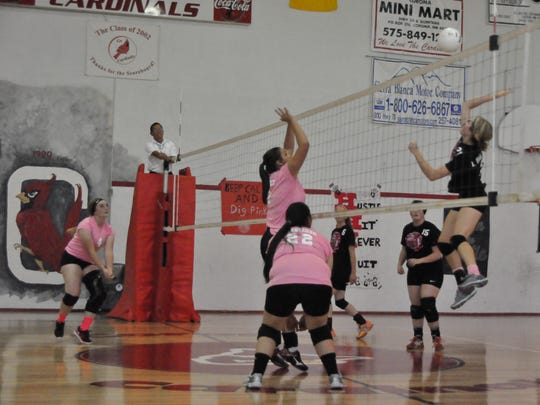 Carrizozo defends at the net against Corona Oct. 15.