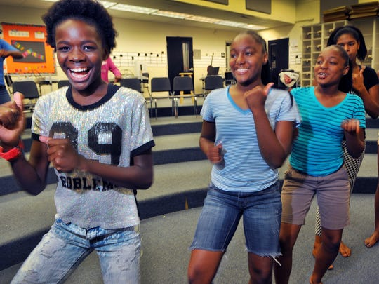 De'yanna Knowles age 12,Tamaria Cooper age 14 and Tammetria Cooper age 14 all of Cocoa rehearse a dance to Waging War by CeCe Winans during one of the programs with the Central Florida YMCA after school program held at Cocoa High.