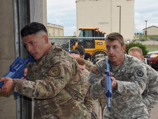 Members of the 143rd Security Forces Company train on building clearance and active shooter scenarios with Malmstrom's tactical response force.
