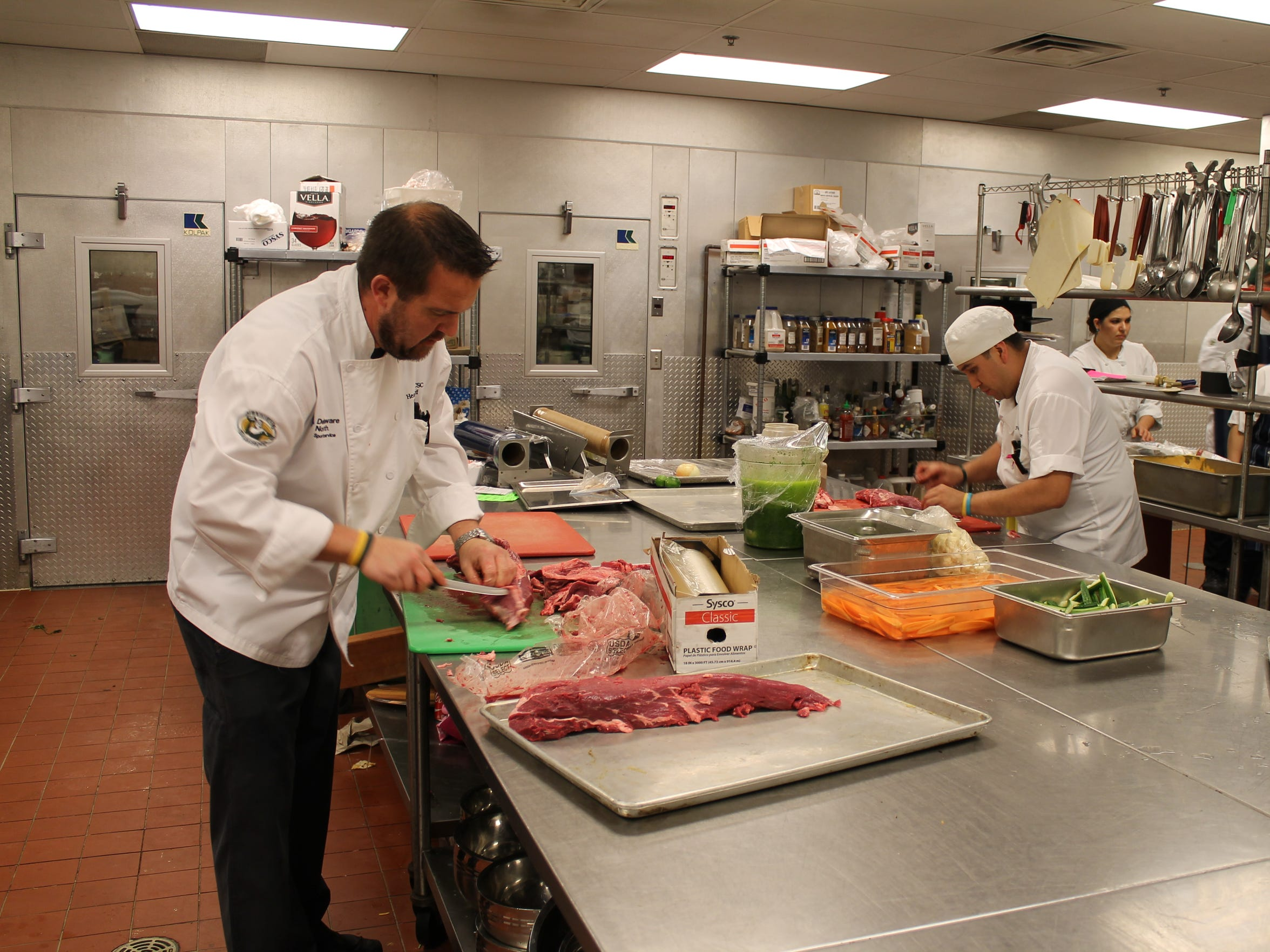 Heath Barbato, Lambeau Field executive chef, is usually a game day manager of his food service team, but steps in to chef work when needed.