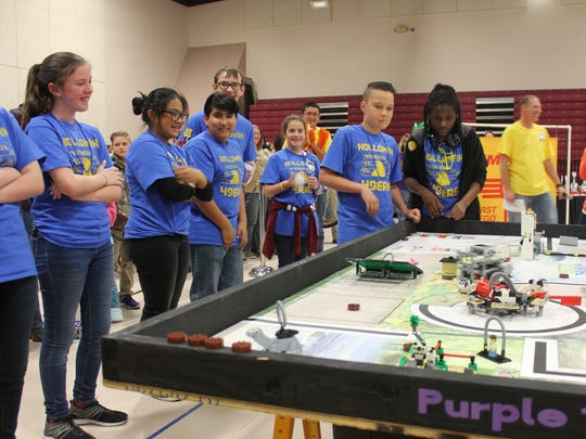 The Holloman 49ers, a LEGO League team from Holloman Middle School, watch their robot compete during the local qualifier in January.