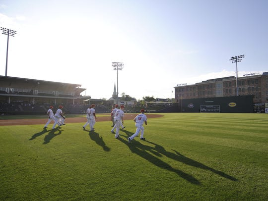 The Greenville Drive take the field for a game in 2012.