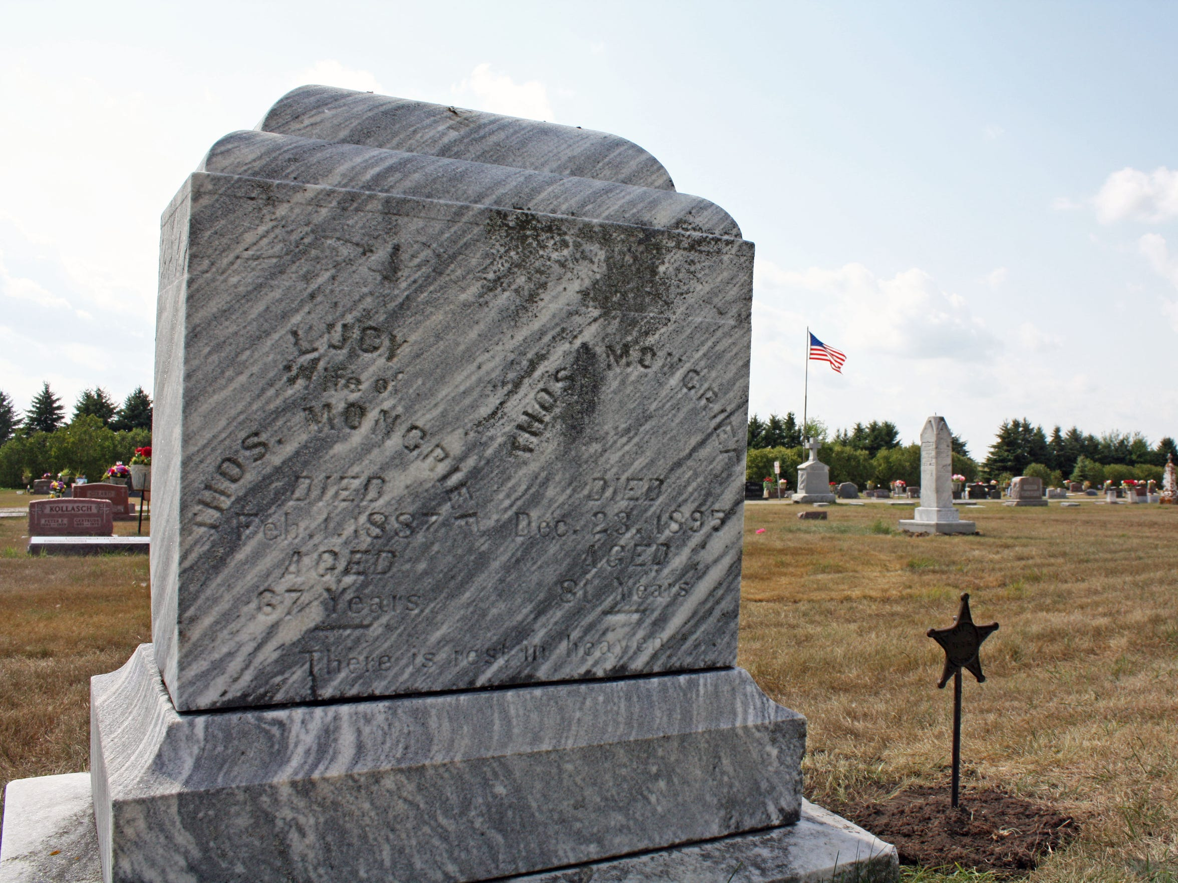 The tombstone of Thomas and Lucy Moncrief in Emmetsburg, Iowa