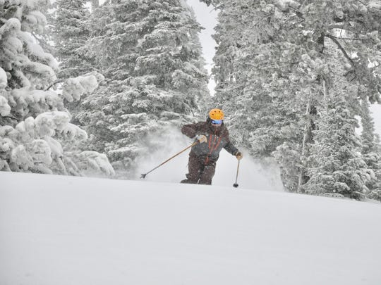 Jake Larson enjoys new powder at Showdown Ski Area Wednesday morning. Beginning Wednesday, Showdown is now open every day through Jan. 1 except Christmas Day.