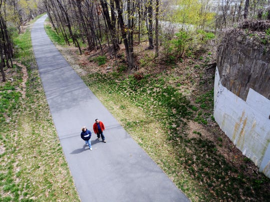 Walkers enjoy the Dutchess Rail Trail near Morgan Lake in the Town of Poughkeepsie.