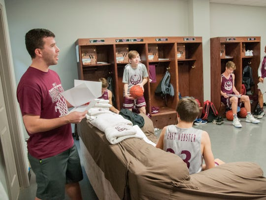Michael Seger meets with his team before practice.