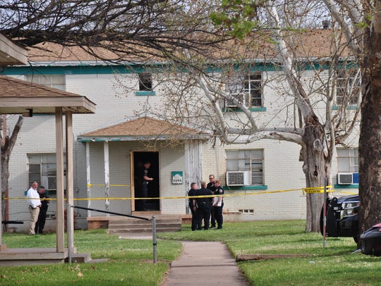 Abilene police stand outside a building at South Creek Apartments at 4044 S. Seventh St. on Friday, after an officer executing an arrest warrant fatally shot a man.