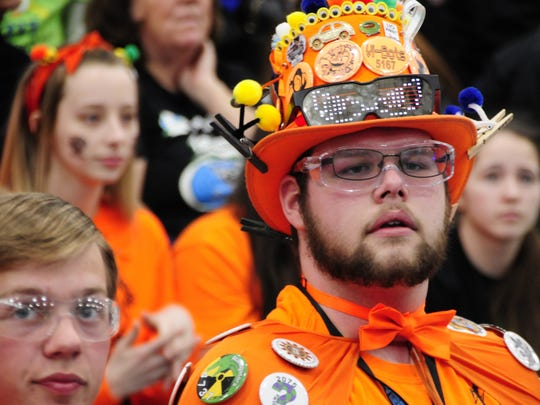 Dion Stephenson, cheer captain for the Marysville Vi-Bots, looks on anxiously as his team competes in the FIRST Robotics District Event at Marysville High School on Saturday, April, 7, 2018.