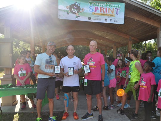 Top Overall Male Finishers, from left: Girl Scout dad David Sempier of Palm City, Gregg Fields of Palm Beach Gardens, and John Daddono, also of Palm Beach Gardens.