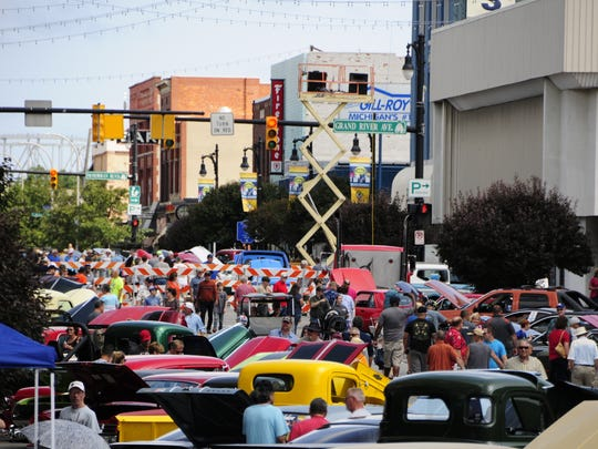 Cars and people crowd Huron Avenue during the MainStreet Memories Car Show in Port Huron on Saturday, July 28, 2018.