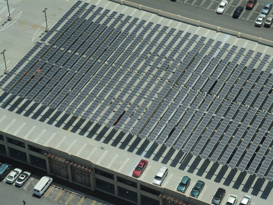 Photovoltaic panels cover a parking lot roof at De