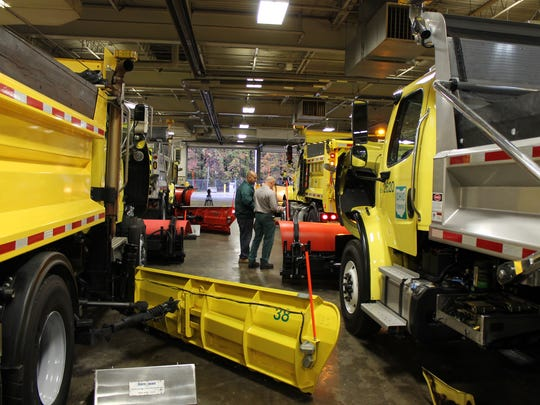Ohio Turnpike inspectors scrutinize snowplow equipment at the Boston Maintenance Garage.