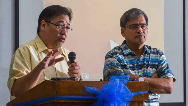 In this July 11 flle photo, Archdiocesan Finance Council member Rick Duenas, left, and Chairmain Richard Untalan answer inquiries on the finances of the Archdiocese of Agana.