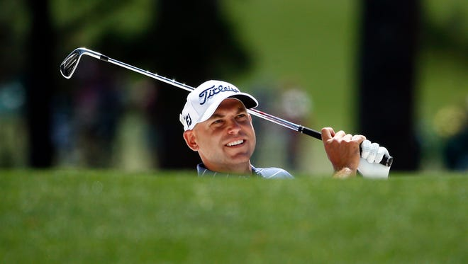Bill Haas hits out of a bunker on the 1st hole during Saturday's third round of The Masters golf tournament at Augusta National Golf Club.