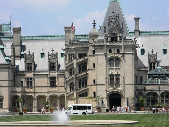 A summer day at Biltmore Estate, where tourists tour Biltmore House, roam the gardens and explore Antler Village.