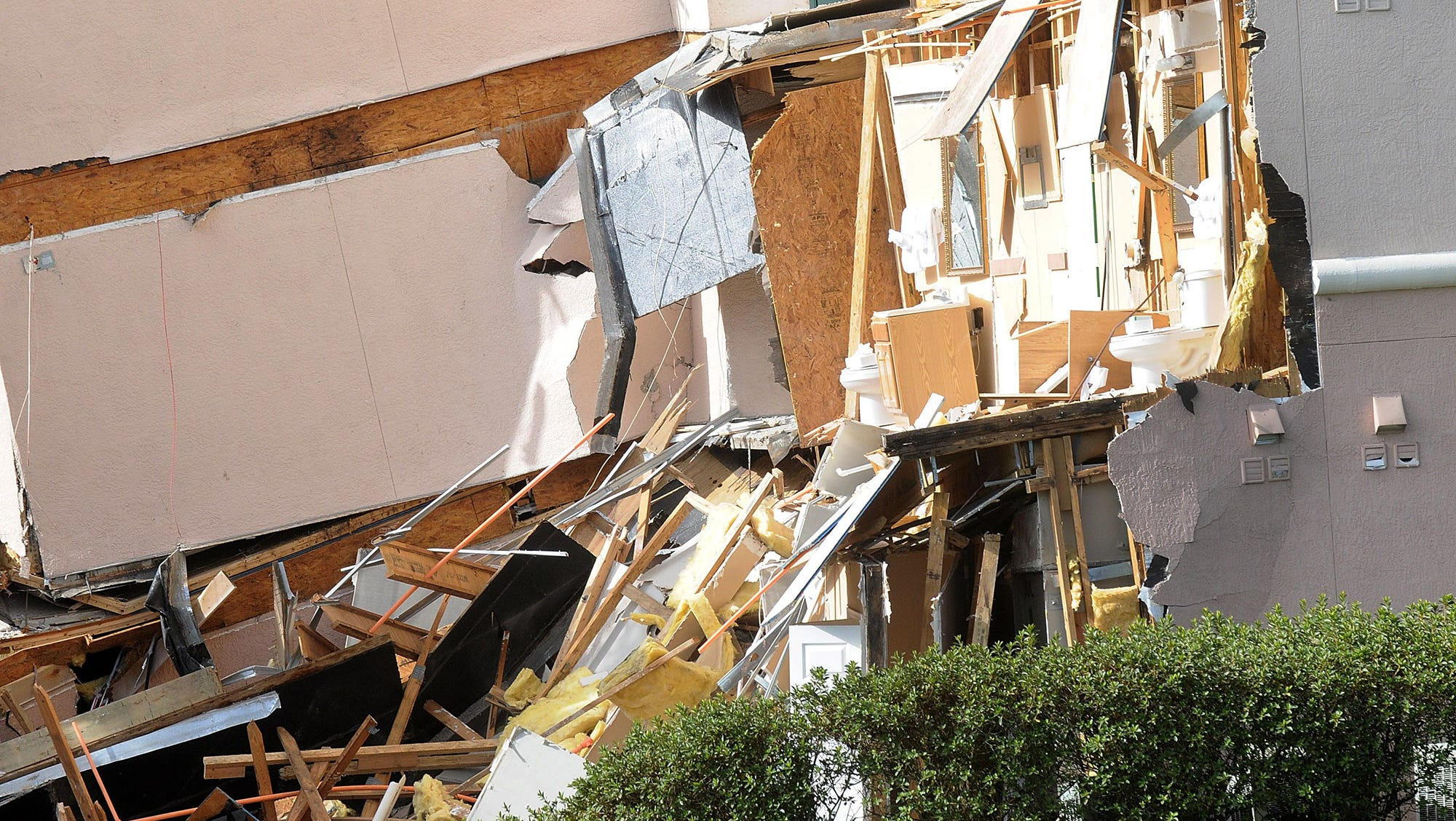 A building sits ripped open at the result of a sinkhole at Summer Bay Resort.