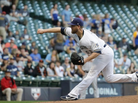 Milwaukee Brewers starting pitcher Jimmy Nelson throws during the first inning of a baseball game against the San Francisco Giants Wednesday, June 7, 2017, in Milwaukee. (AP Photo/Morry Gash)