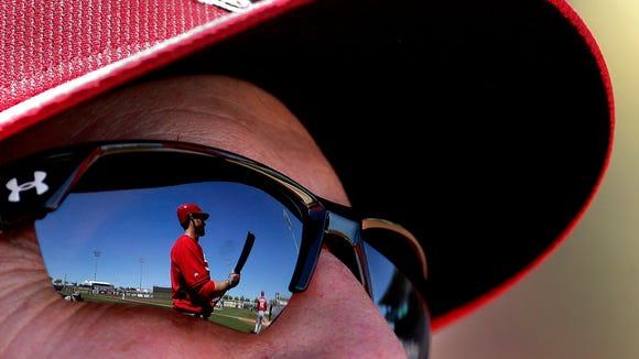 Cincinnati Reds' Brennan Boesch is reflected in manager
