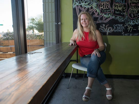 Candice Rice, owner of Adventures 2000, poses at Sip Coffee & Beer Garage on Friday, Aug. 11, 2017 in Phoenix, Ariz.
