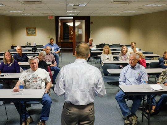 Members of the Marion County Tea Party listen as Rep.