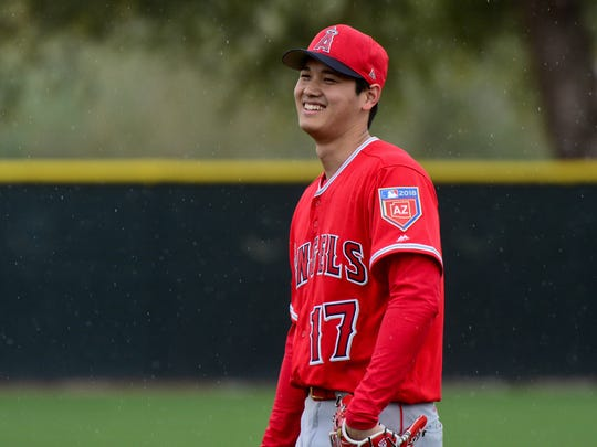 Angels pitcher Shohei Ohtani looks on in the rain during