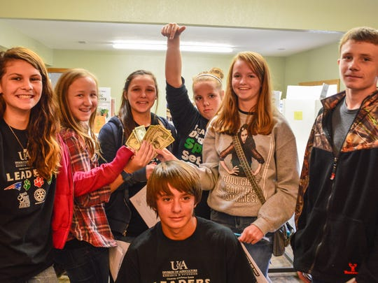 South Shore Rotary/Marion County Youth Leadership team members in the 'Get Real Here's the Deal' exercise where some end up with no money and others who 'made the bank' during the simulation.