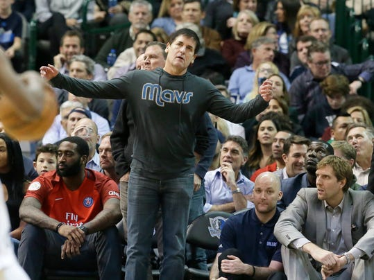 Dallas Mavericks owner Mark Cuban reacts to a call during the second half of an NBA basketball game between the Mavericks and San Antonio Spurs in Dallas, Wednesday, Nov. 30, 2016. The Spurs won 94-87. (AP Photo/LM Otero)