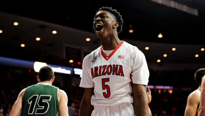 Arizona forward Stanley Johnson celebrates during the first half against Utah Valley at McKale Center.