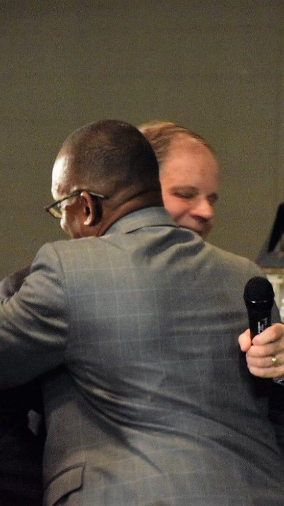 Democratic Senate nominee Doug Jones embraces Sen. Bobby Singleton, D-Greensboro, at a dinner in Greensboro on Nov. 26, 2017.