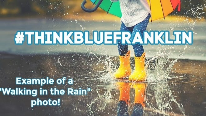 """Walking in the Rain"" is one of four categories in Franklin's #ThinkBlueFranklin contest. Participants are invited to go out in the rain, examine where rainwater flows and to take a picture of themselves in the rain."