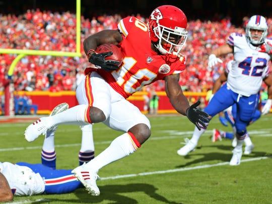 Kansas City Chiefs wide receiver Tyreek Hill returns a punt against the Buffalo Bills in the first half at Arrowhead Stadium.