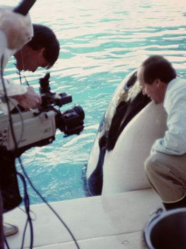 """Rothmiller working with a killer whale on his ESPN show """"The Gamesman."""""""