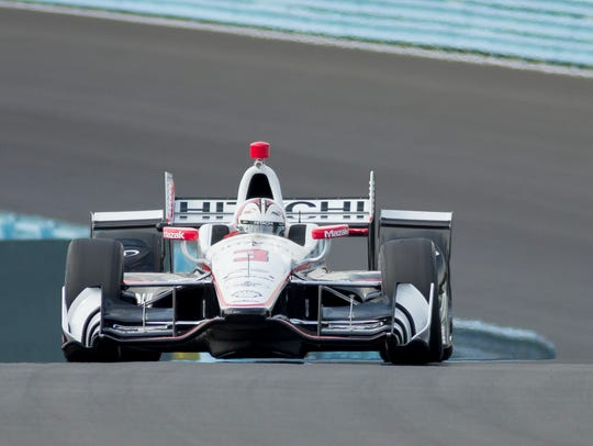 Helio Castroneves enters the Esses during testing for