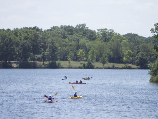 Kayakers enjoy the waterways at Kensington Metropark.